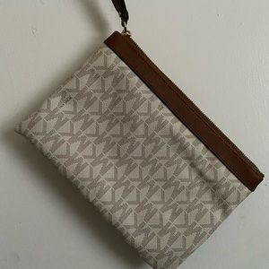 tan and brown Michael Kors zip pouch
